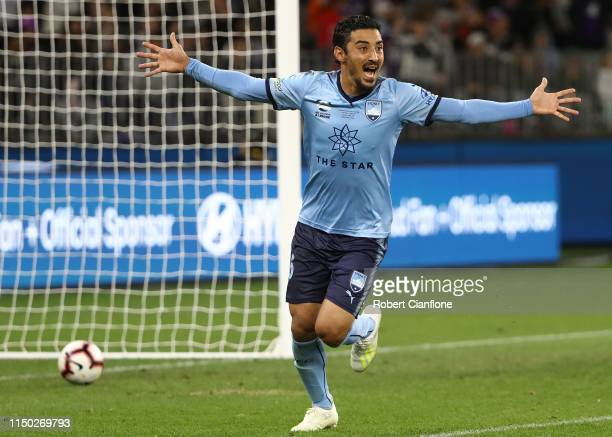 Reza Ghoochannejahd of Sydney FC celebrates after he scored the winning penalty during the 2019 ALeague Grand Final match between the Perth Glory and...