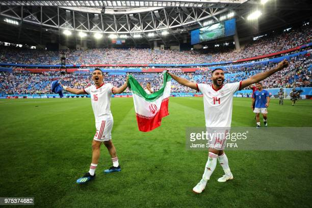Reza Ghoochannejhad and Saman Ghoddos of Iran celebrate their side's win following the 2018 FIFA World Cup Russia group B match between Morocco and...