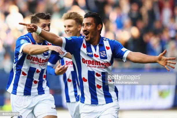 Reza Ghoochannejhad of Heerenveen celebrates scoring his teams second goal of the game with Arber Zeneli during the Dutch Eredivisie match between SC...