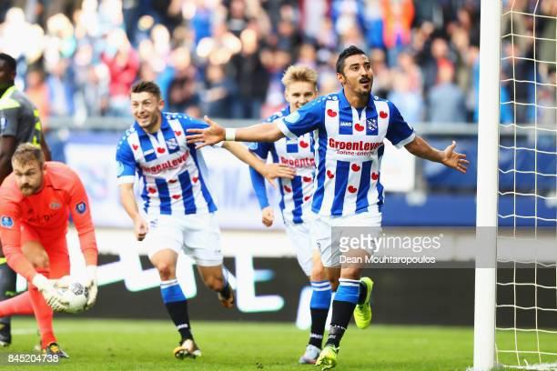 Reza Ghoochannejhad of Heerenveen celebrates scoring his teams second goal of the game during the Dutch Eredivisie match between SC Heerenveen and...
