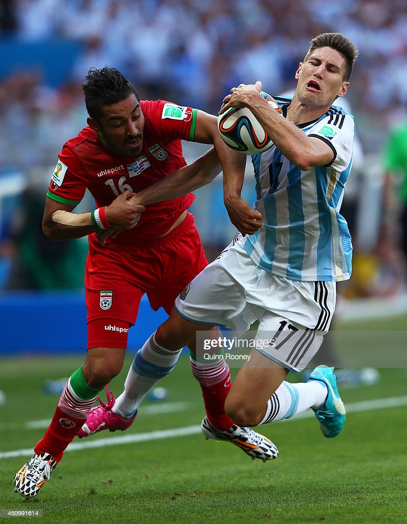 Reza Ghoochannejhad of Iran and Federico Fernandez of Argentina compete for the ball during the 2014 FIFA World Cup Brazil Group F match between Argentina and Iran at Estadio Mineirao on June 21, 2014 in Belo Horizonte, Brazil.