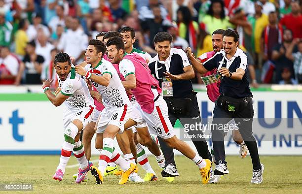 Reza Ghoochannejhad of Iran celebrates a scoring a goal in extra time with team mates during the 2015 Asian Cup match between Iran and Iraq at...