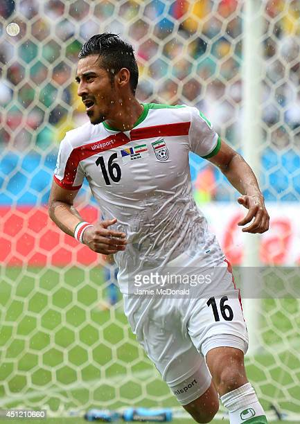 Reza Ghoochannejhad of Iran celebrates scoring his team's first goal during the 2014 FIFA World Cup Brazil Group F match between Bosnia and...