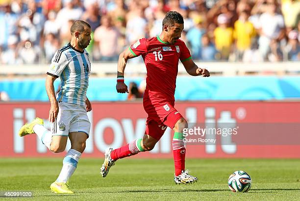 Reza Ghoochannejhad of Iran controls the ball against Javier Mascherano of Argentina during the 2014 FIFA World Cup Brazil Group F match between...
