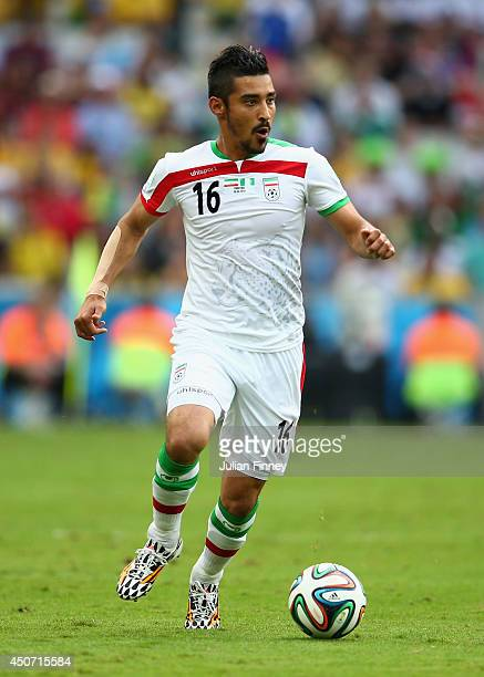 Reza Ghoochannejhad of Iran controls the ball during the 2014 FIFA World Cup Brazil Group F match between Iran and Nigeria at Arena da Baixada on...