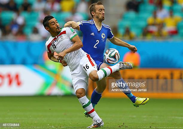 Reza Ghoochannejhad of Iran in action against Avdija Vrsajevic during the 2014 FIFA World Cup Brazil Group F match between Bosnia and Herzegovina and...