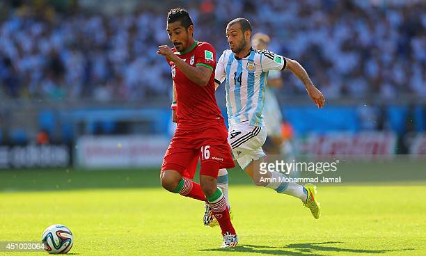 Reza Ghoochannejhad of Iran in action against Javier Mascherano of Argentina during the 2014 FIFA World Cup Brazil Group F match between Argentina...