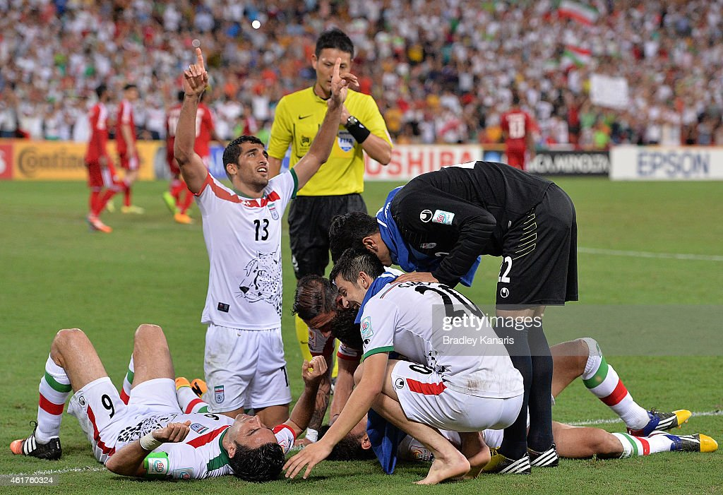 Reza Ghoochannejhad (L) of Iran is congratulated by team mates after scoring a goal during the 2015 Asian Cup match between IR Iran and the UAE at Suncorp Stadium on January 19, 2015 in Brisbane, Australia.