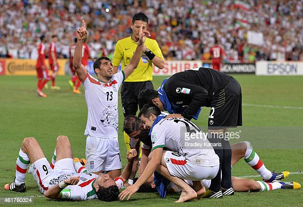 Reza Ghoochannejhad of Iran is congratulated by team mates after scoring a goal during the 2015 Asian Cup match between IR Iran and the UAE at...
