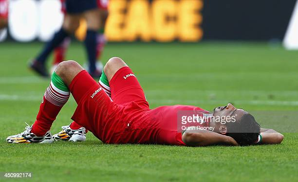 Reza Ghoochannejhad of Iran lies on the field after being defeated by Argentina 10 during the 2014 FIFA World Cup Brazil Group F match between...