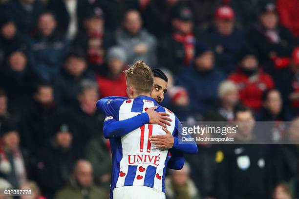 Reza Ghoochannejhad of sc Heerenveen celebrates scoring his teams first goal of the game with team mate Sam Larsson during the Dutch Eredivisie match...