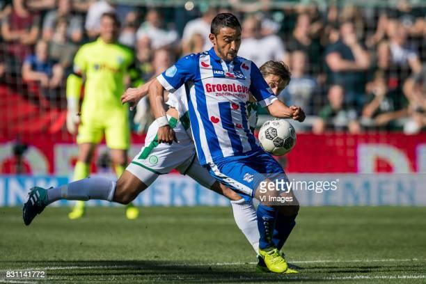 Reza Ghoochannejhad of sc Heerenveen Etienne Reijnen of FC Groningen during the Dutch Eredivisie match between FC Groningen and sc Heerenveen at...