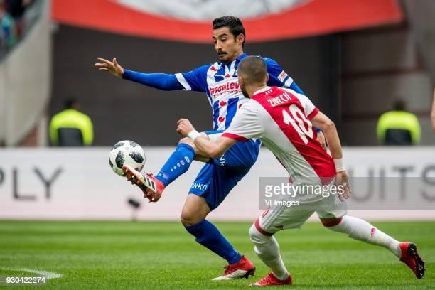 Reza Ghoochannejhad of sc Heerenveen Hakim Ziyech of Ajax during the Dutch Eredivisie match between Ajax Amsterdam and sc Heerenveen at the Amsterdam...