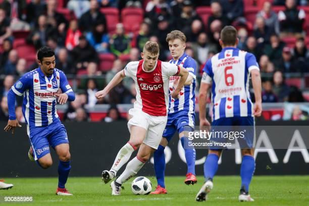 Reza Ghoochannejhad of SC Heerenveen Matthijs de Ligt of Ajax Martin Odegaard of SC Heerenveen during the Dutch Eredivisie match between Ajax v SC...