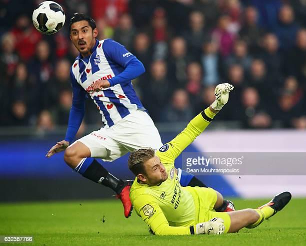 Reza Ghoochannejhad of sc Heerenveen shoots and scores a goal past Goalkeeper Jeroen Zoet of PSV during the Dutch Eredivisie match between PSV...