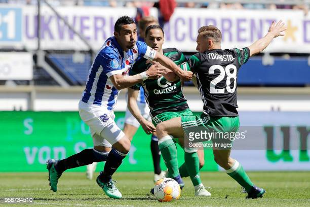Reza Ghoochannejhad of SC Heerenveen Sofyan Amrabat of Feyenoord Jens Toornstra of Feyenoord during the Dutch Eredivisie match between SC Heerenveen...