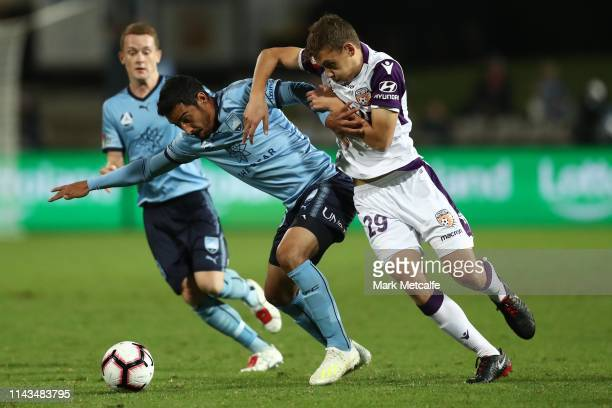 Reza Ghoochannejhad of Sydney and Jake Brimmer of the Glory compete for the ball during the round 26 ALeague match between Sydney FC and Perth Glory...