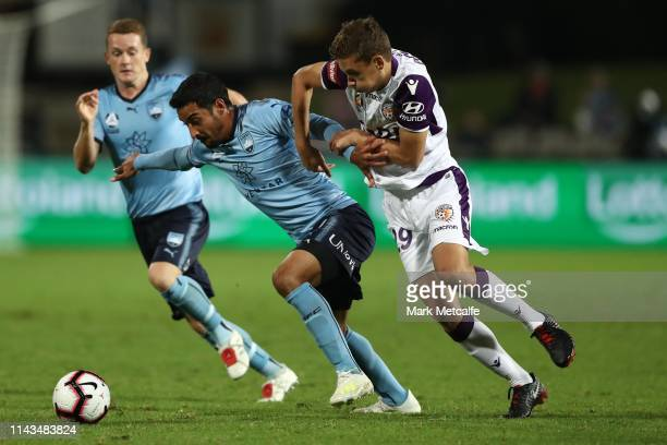 Reza Ghoochannejhad of Sydney and Jake Brimmer of the Glory compete for the ball during the round 26 A-League match between Sydney FC and Perth Glory...