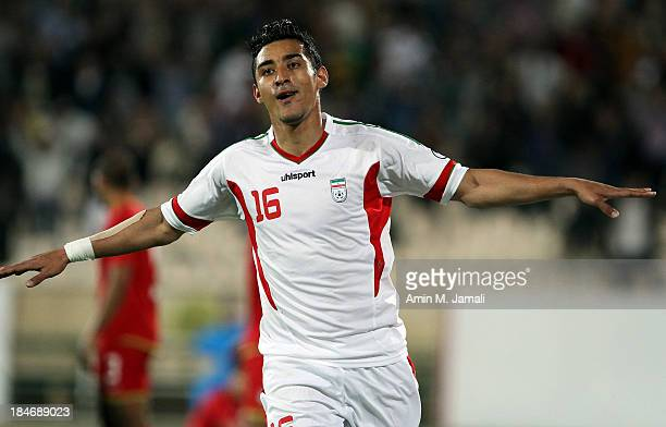 Reza Ghouchannejad celebrates scoring during AFC Asian Cup Qualifiers between Iran and Thailand at Azadi Stadium Tehran Iran on October 15 2013 in...
