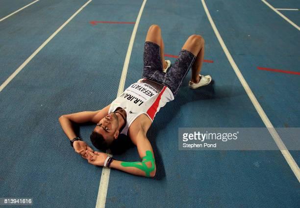 Reza Kefayati of Iran lies on the floor following the 1500m in the boys decathlon on day two of the IAAF U18 World Championships at the Kasarani...