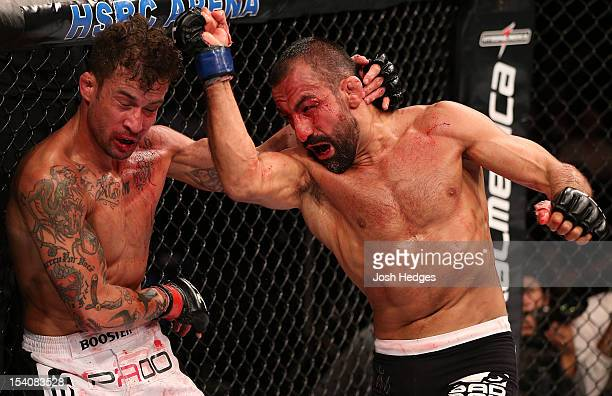 Reza Madadi punches Cristiano Marcello during their lightweight fight at UFC 153 inside HSBC Arena on October 13 2012 in Rio de Janeiro Brazil
