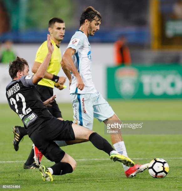 Reziuan Mirzov of FC Tosno and Aleksandr Yerokhin of FC Zenit Saint Petersburg vie for the ball during the Russian Football League match between FC...