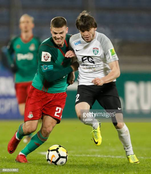 Reziuan Mirzov of FC Tosno and Igor Denisov of FC Lokomotiv Moscow vie for the ball during the Russian Football League match between FC Tosno and FC...