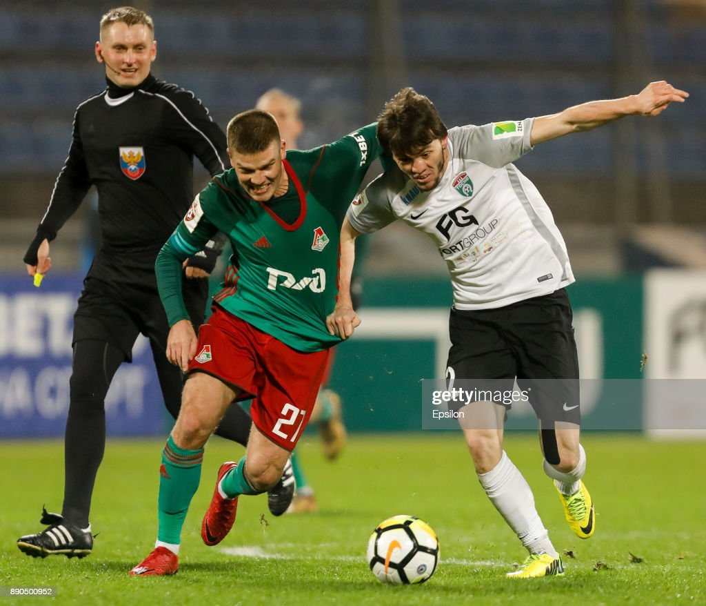 Reziuan Mirzov (R) of FC Tosno and Igor Denisov of FC Lokomotiv Moscow vie for the ball during the Russian Football League match between FC Tosno and FC Lokomotiv Moscow on December 11, 2017 at Petrovsky Stadium in Saint Petersburg, Russia.