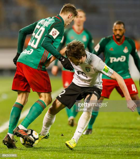 Reziuan Mirzov of FC Tosno vies for the ball with Aleksei Miranchuk of FC Lokomotiv Moscow during the Russian Football League match between FC Tosno...