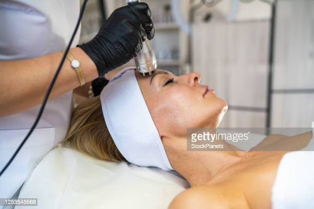 rf lifting procedure in a beauty salon - buttock photos stock pictures, royalty-free photos & images
