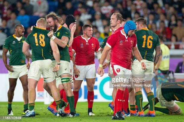 Rg Snyman and his team mate Vincent Koch of South Africa celebrate with a defeated Wales side during the Rugby World Cup 2019 Semi-Final match...