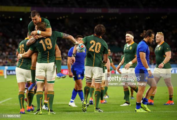 Rg Snyman of South Africa celebrates with teammate Handre Pollard after scoring his team's sixth try during the Rugby World Cup 2019 Group B game...