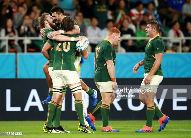 Rg Snyman of South Africa celebrates with teammates after scoring his team's sixth try during the Rugby World Cup 2019 Group B game between South...