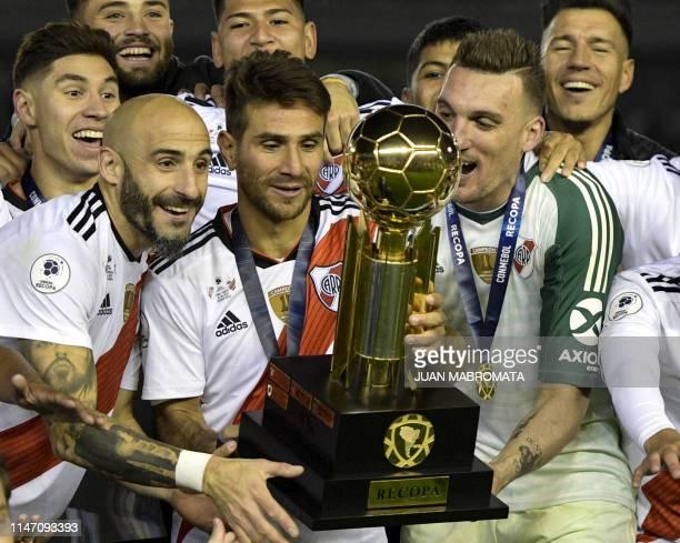 rgentina's River Plate midfielder Leonardo Ponzio defender Javier Pinola and goalkeeper Franco Armani rise the trophy of the Recopa Sudamericana...
