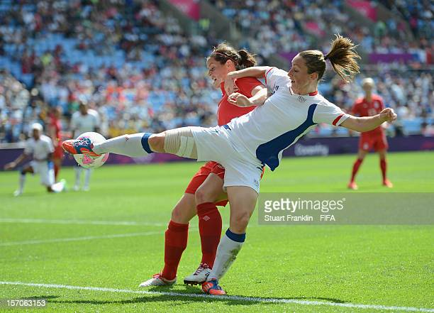 Rhain Wilkinson of Canada challenges for the ball with Gaetane Thiney of France between the Olympic womens bronze medal match between Canada and...