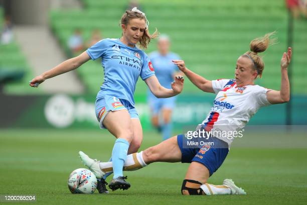 Rhali Dobson of Melbourne City is tackled by Hannah Brewer of the Jets during the round 10 W-League match between Melbourne City and the Newcastle...