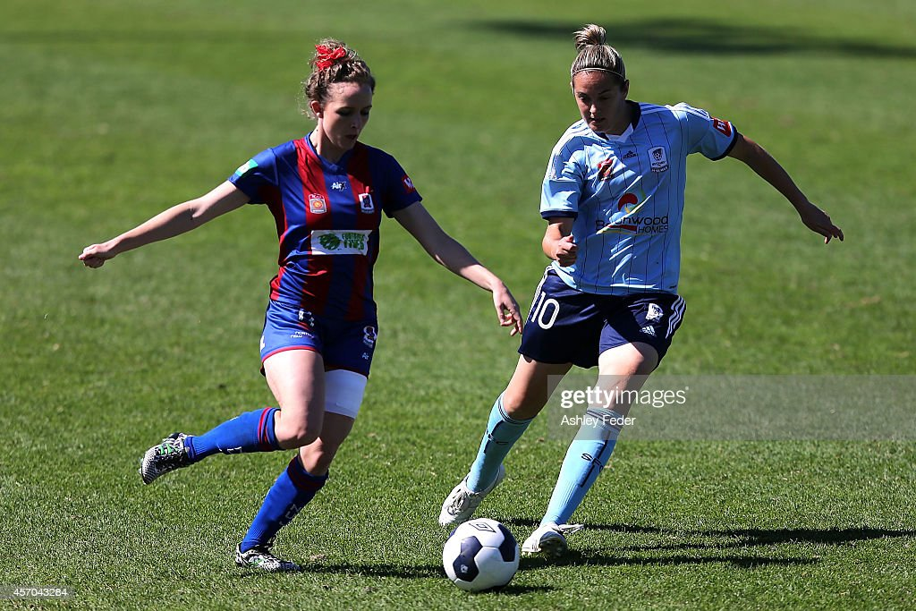 Rhali Dobson of the Jets contests the ball against Renee Rollason of Sydney FC during the round five W-League match between the Newcastle Jets and Sydney FC at Magic Park on October 11, 2014 in Newcastle, Australia.