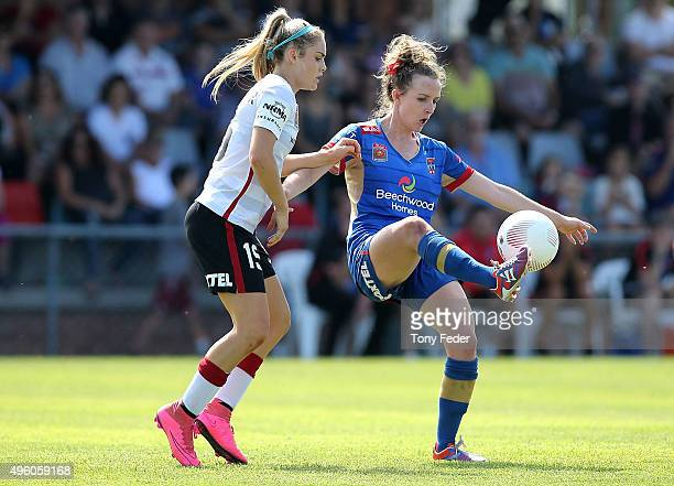 Rhali Dobson of the Jets contests the ball with Ellie Carpenter of the Wanderers during the round four WLeague match between the Newcastle Jets and...