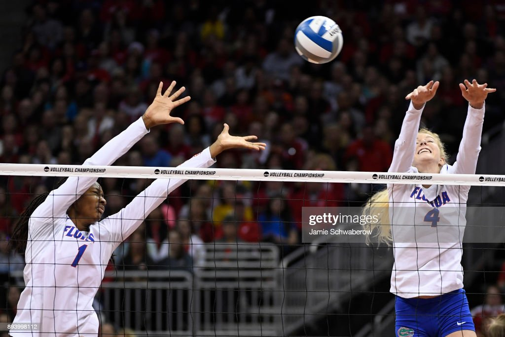 Rhamat Alhassan (1) and Carli Snyder (4) of the University of Florida reach for a spiked ball during the Division I Women's Volleyball Championship held at Sprint Center on December 16, 2017 in Kansas City, Missouri.