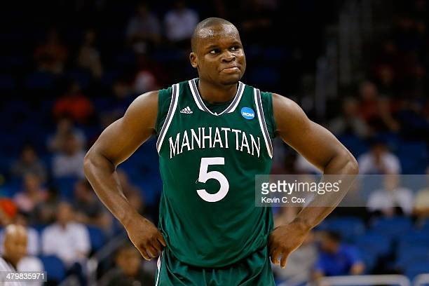 Rhamel Brown of the Manhattan Jaspers reacts after fouling out against the Louisville Cardinals in the second half during the second round of the...