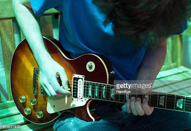 Rhapsody in Blue: young guitarist playing Gibson Les Paul Standard