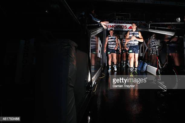 Rhe Geelong Cats run out before the round 16 AFL match between the Geelong Cats and the Western Bulldogs at Skilled Stadium on July 6, 2014 in...