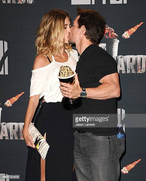 Rhea Durham and Mark Wahlberg pose in the press room at the 2014 MTV Movie Awards at Nokia Theatre LA Live on April 13 2014 in Los Angeles California