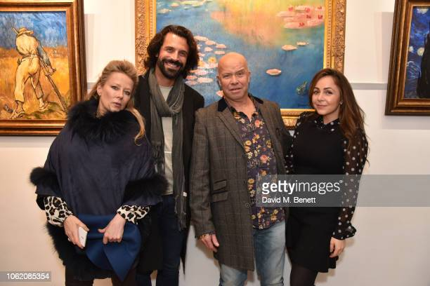 Rhea ElliottJones Christian Vit Paul Karslake and Laura Adrianna Romanin attend a private view of artist Paul Karslake's exhibition at The Marylebone...