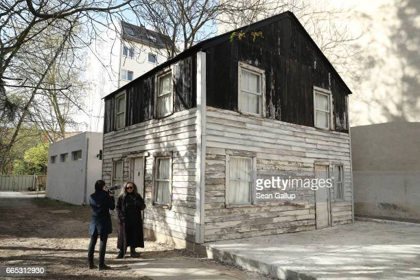 Rhea McCauley niece of AfroAmerican human rights figure Rosa Parks speaks to a journalist while standing next to the former house of Rosa Parks on...