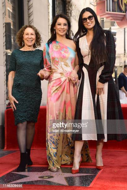 Rhea Perlman Lucy Liu and Demi Moore attend a ceremony honoring Liu with a star on the Hollywood Walk Of Fame on May 1 2019 in Hollywood California