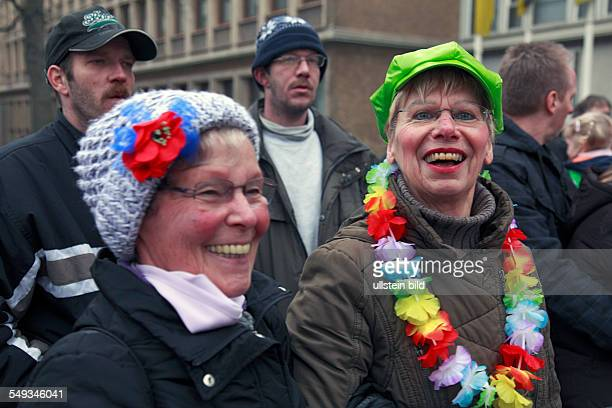 Rheinish Carnival in Krefeld North RhineWestphalia two women watching a parade at Old Women Day or The Women's Day