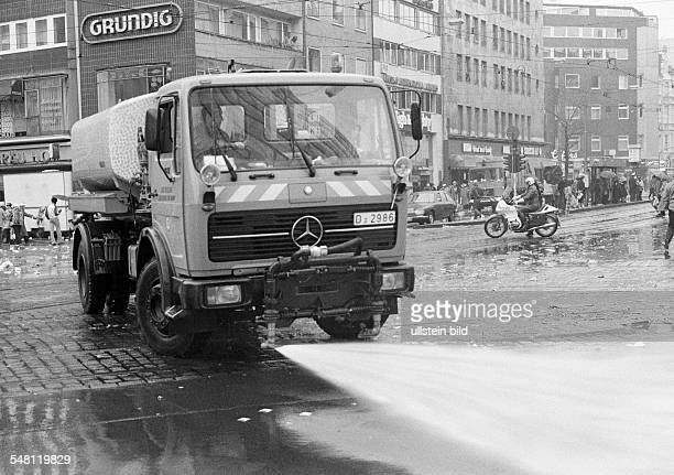 Rhenish carnival Rose Monday parade 1981 street cleaning after finishing the parade road sweeper DDuesseldorf Rhine North RhineWestphalia