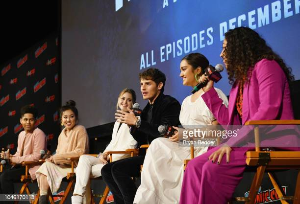 Rhenzy Feliz Lyrica Okano Virginia Gardner Gregg Sulkin Ariela Barer and Allegra Acosta speak onstage during Hulu's 'Runaways' panel at 2018 New York...