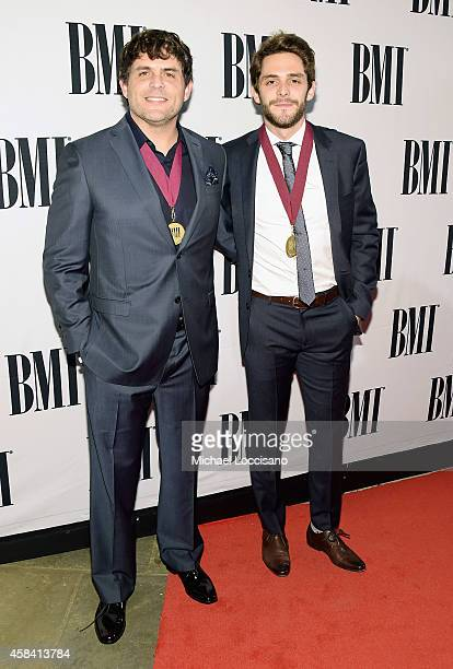 Rhett Akins and Thomas Rhett attends the 62nd annual BMI Country awards on November 4 2014 in Nashville Tennessee